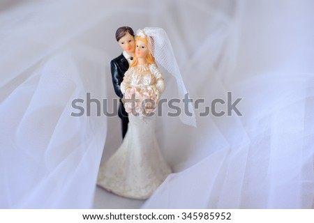 Top figurines of bride and groom