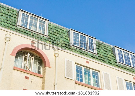 Top floor apartments in a London building - stock photo