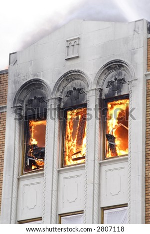 Top floor of a Detroit Apartment on fire - stock photo