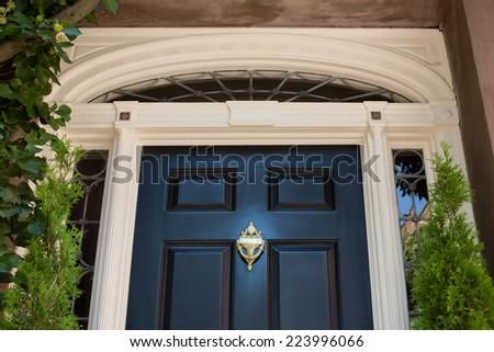 Top Half of Black Front Door with White Door Frame  - stock photo