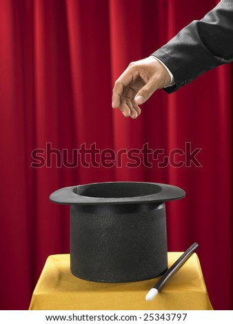top hat on the stage with magician - stock photo