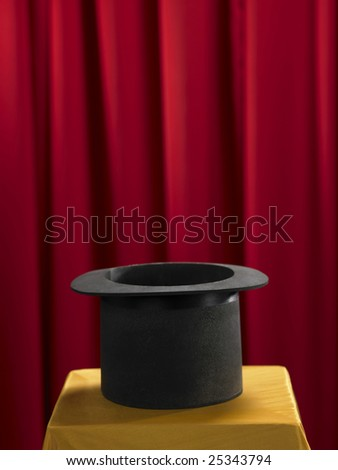 top hat on the stage with red curtain - stock photo