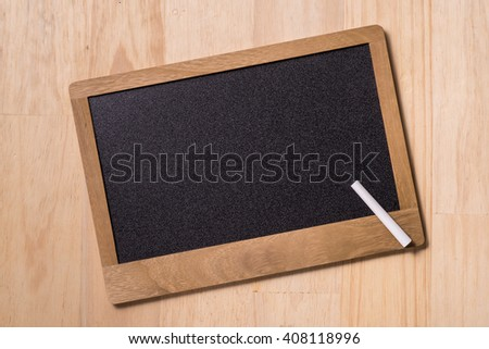 top image of chalkboard and white chalks over wooden table
