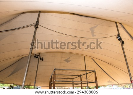 Top inside of a large tent with lights and cables - stock photo