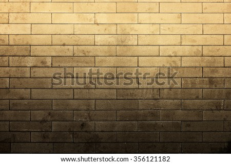 top light up dirty stain with texture brick wall - stock photo
