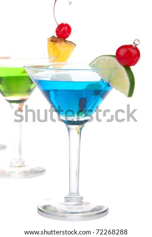 Top Martini Cocktail drinks blue and green with vodka, light rum, gin, tequila, blue curacao, lime juice, pineapple, cherry in classic cocktails glasses isolated on a white background - stock photo