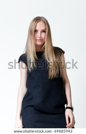 Top model looking lady. Fresh new young face. Studio shot, uniform background. - stock photo