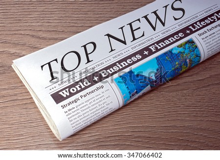Top News Newspaper on wooden background - stock photo