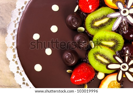Top of a cake with fresh fruits - stock photo