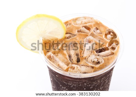 top of a glass of cola or coke with ice cubes, lemon slice and peppermint garnish, closeup with selected focus and narrow depth of field  - stock photo