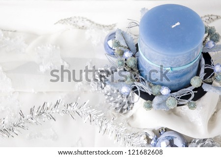 top of blue candle on white background