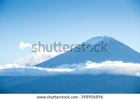 Top of mount Fuji with beautiful clouds in early winter, This mountain is famous place of japan - stock photo