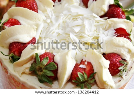 Top of strawberry shortcake with white chocolate shavings - stock photo