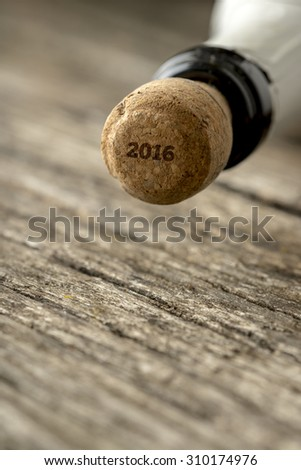 Top of the champagne bottle with 2016 sign on the cork - seasonal celebrations and new years concept. - stock photo