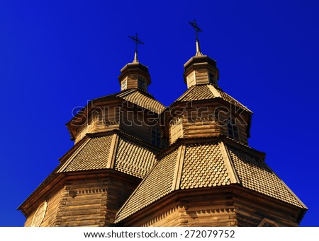Top of the domes of wooden cossack church Covers of the Blessed Virgin on the island Hortitsa in Zaporozhye, Ukraine  - stock photo