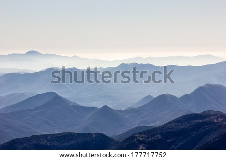 top of the mountain with snow on a sunny day - stock photo