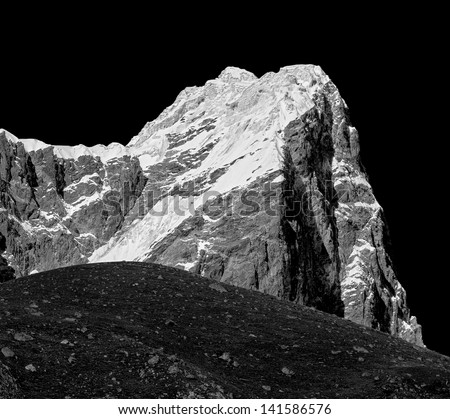 Top of the Tabuche (6367 m) peak on background, view from Periche village - Everest region, Nepal, Himalayas (black and white)