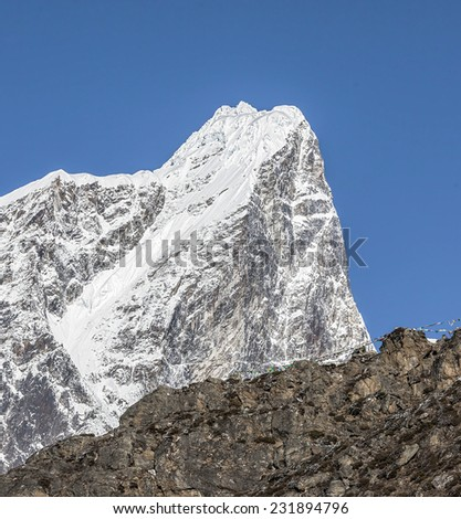 Top of the Tabuche peak. View from the village Dingboche in the valley Chhukhung - Nepal, Himalayas - stock photo