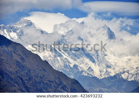 Top of the world - Mount Everest, Lhotse and Nuptse summits. Himalayas mountain panorama. - stock photo