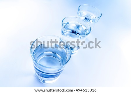 top of view of drink glasses with water, nutrition and health-care concept, nutrition and health-care concept on white background
