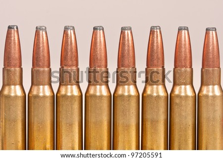 Top part of rifle bullets packed in a row
