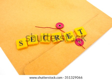 top secret  concept with plastic letter and brown letter sheet isolated on white.  - stock photo