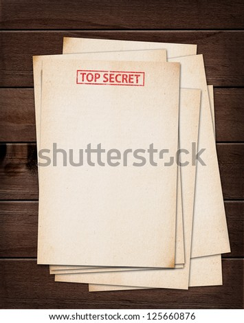 top secret files on wooden table. - stock photo