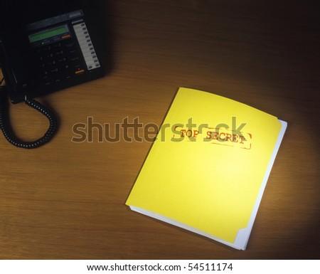 Top Secret Folder on Desk - stock photo