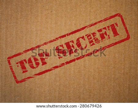 Top secret rubber stamp impression on brown paper background - stock photo
