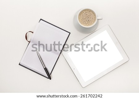Top. tablet pc with open notebook and cup of coffee - stock photo