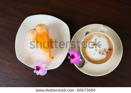 Top view a cup of coffee and cake on table - stock photo