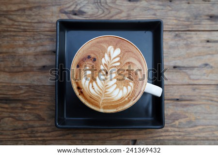 Top view, A cup of coffee mocha on wooden - stock photo