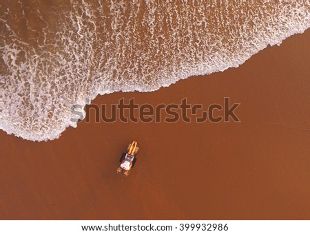 Top view air shooting from flying drone of hipster girl is using laptop for remote work, while is lying on sunbed near sea with copy space background for your advertising text message or content - stock photo