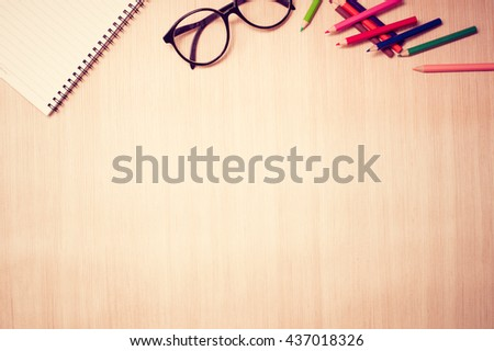 Top view artist table with color pencil and notebook. Retro filter - stock photo