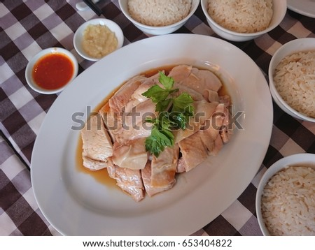 Top View Asian Food Of Singapore Chicken Rice Steam Chicken With Sauce And Garlic