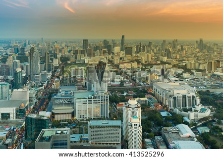 Top view Bangkok central business area with sunset sky background, Thailand - stock photo