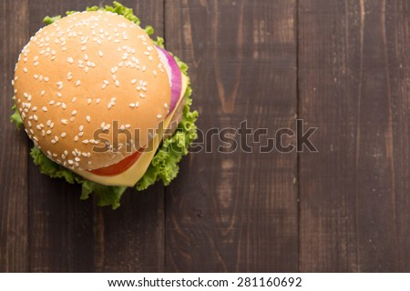 Top view bbq hamburger on the wooden background - stock photo