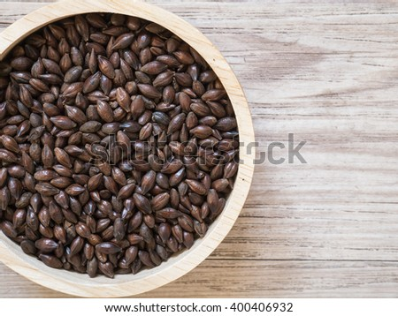 Top view - Beer ingredients, Chocolate malt on wooden background ( Space and composition for text ) - stock photo