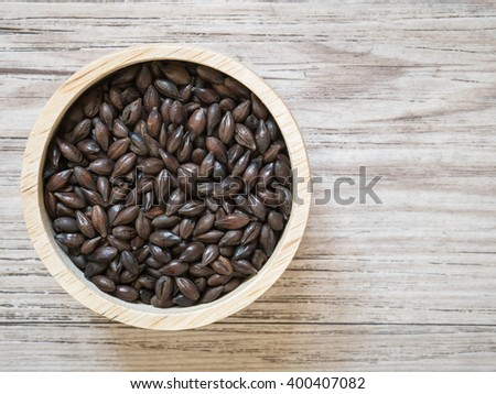 Top view - Beer ingredients, Roast malt on wooden background ( Space and composition for text ) - stock photo