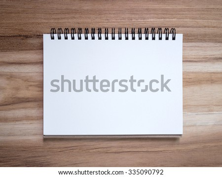 Top view Blank Notebook paper on wood texture background