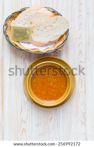 Top view - Bowl of minestrone soup with bread  - stock photo
