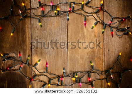 Top view, Christmas and New Year lights on old wood background  - stock photo