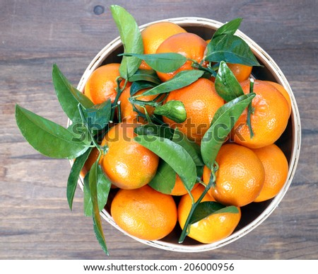 top view  clementine mandarin fruit in bucket display at market place  - stock photo
