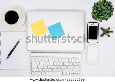 Top view close laptop or notebook workspace office on white table - stock photo