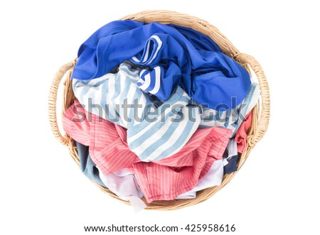 Top view Clothes on wicker baskets for washing preparations whit white background - stock photo