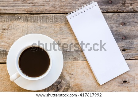 top view cup of coffee  with paper note on wood table background