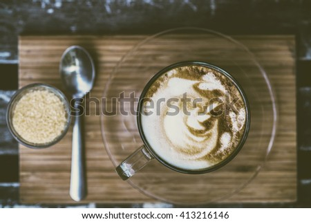 Top view Cup of Love coffee on old wooden table with red heart vintage style - stock photo