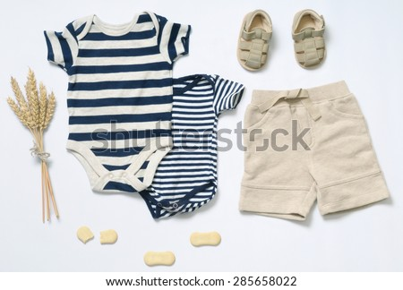 top view fashion trendy look of baby clothes and toy stuff, baby fashion concept  - stock photo