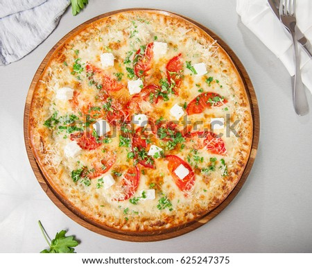 Top View Four Cheese Pizza Quattro Fromaggi On A Rustic Wooden Board On The  Table With