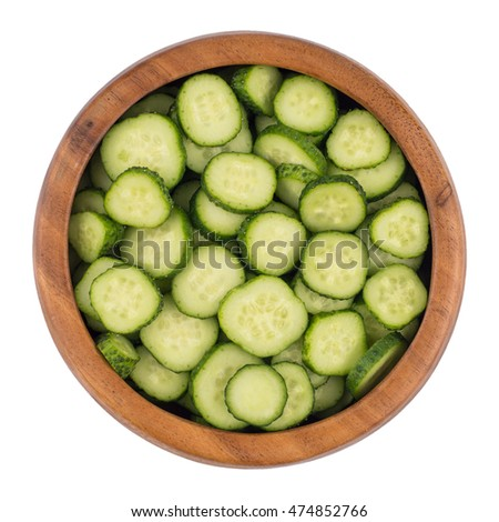 Top view Fresh slice cucumber in wood bowl on white background